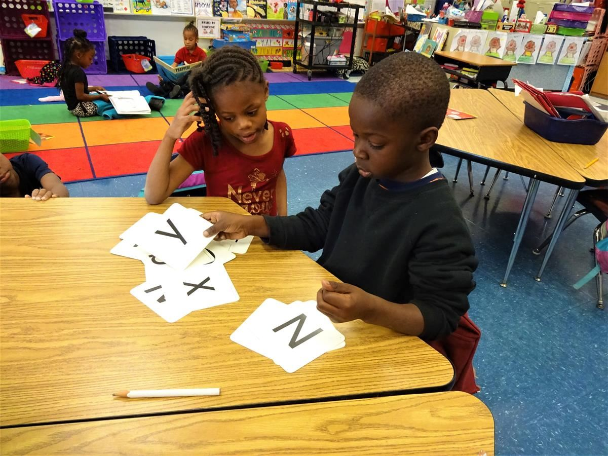 Two students learning the Alphabet.