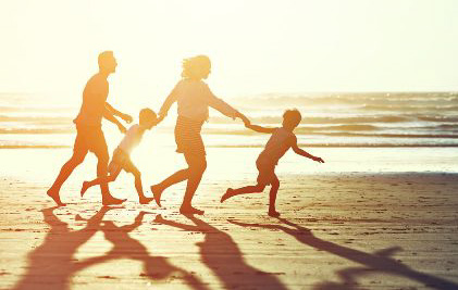 Silhouette Image of a family running on the beach